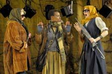 Omoze Idehenre, center, plays a poor woman on the run who tries to enlist the aid of two wealthy women (Rene Augesen and Caroline Hewitt). Photo: Kevin Berne