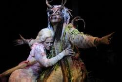 "Rapunzel (Jamie Wood Katz) embraces the Witch (Angela Robinson) who acts as her mother and keeps her confined in a towner, in Alliance Theatere's production of ""Into the Woods"""