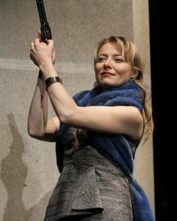 Marya Sea Kaminski playing with firearms as the title character in Intiman's Hedda Gabler