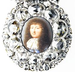 Presentation miniature of Louis XIV in a diamond-set frame, ca. 1670. Workshop of Pierre and Laurent Le Tessier de Montarsy, goldsmiths; Jean Petitot I, enameler. Miniature: painted enamel. Mount: rose-cut and table-cut diamonds set in silver and enameled gold. Musee du Louvre, Departement des Objets dArt, Gift of the Societe des Amis. (Photo: RMN-Grand Palais/Art Resource, NY/Jean-Gilles Berizzi)