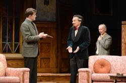 Mr. Paravicini (David Pichette) interviewed by Detective Trotter (Jared Michael Brown). Major Metcalf (R. Hamilton Wright) looks on in Village Theatre's 'The Mousetrap'