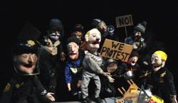 Puppet Gunnar Oddmunson (center) and fellow protesters
