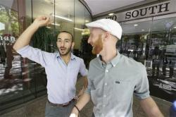 Plaintiffs Moudi Sbeity, left, and his partner Derek Kitchen, one of three couples who brought a lawsuit against Utah's gay marriage ban, celebrate as they arrive at their lawyer's office.