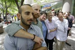 From left, plaintiffs Moudi Sbeity and Derek Kitchen, Kate Call, Laurie Wood and Kody Partridge, five of the six people who brought the lawsuit against the Utah's gay marriage ban.