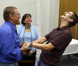 Adam Shoffner, right, shouts his joy after he married Daniel Tolliver, left, as Marion County Clerk Beth White looks on as same sex couple continued to be married for the second day in Indianapolis,