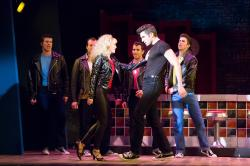 Becca Andrews (Sandy) and Zach Trimmer (Danny) and the cast of 'Grease'