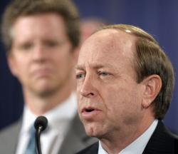 Housing and Urban Development (HUD) Secretary Shaun Donovan listens at left as Colorado Attorney General John Suthers speaks.