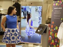 Sales manager Alysa Stefani demonstrates the Memory Mirror at the Neiman Marcus store in San Francisco's Union Square.