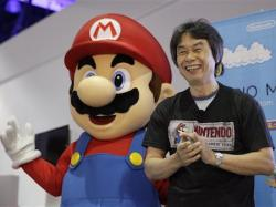 Japanese video game designer Shigeru Miyamoto introduces the Nintendo's Mario Maker during a press event at the Nintendo booth at the Electronic Entertainment Expo, in Los Angeles.