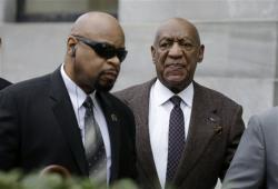 Bill Cosby, right, arrives for a court appearance in Norristown, Pa.