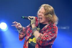 Axl Rose of the band AC/DC performs at the Olympic Stadium in London.