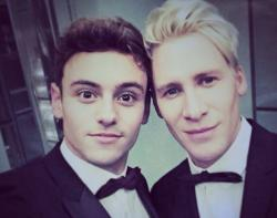 Tom Daley (left) with fiancé Dustin Lance Black.