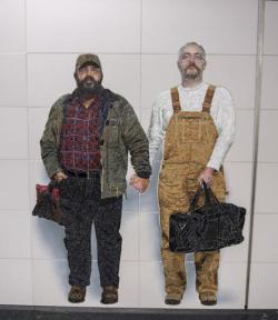 A mural on the wall of the Second Avenue Subway station at 72nd Street, in New York, shows Thor Stockman, left, and his husband, Patrick Kellogg.