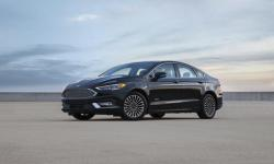 This undated photo provided by the Ford Motor Company shows the 2017 Ford Fusion Energi. The Ford Fusion Energi plug-in, gasoline-electric hybrid sedan is more fuel efficient for 2017 and more affordable than ever with a new starting retail price of $31,995