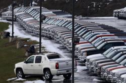 In this Wednesday, Jan. 9, 2013, file photo, Chevy trucks line the lot of a dealer in Murrysville, Pa.