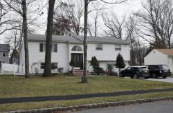 In this Jan. 5, 2017, photo, the home of Dan Zhong is seen in Livingston, N.J. Zhong, a businessman imprisoned on charges that he forced immigrant laborers to do construction at Chinese diplomatic facilities in the U.S. wants permission to turn his New Jersey home into a private jail where he can comfortably await trial
