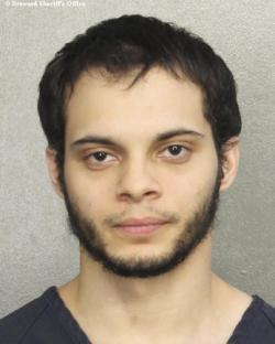 This file booking photo provided by the Broward Sheriff's Office shows suspect Esteban Santiago in Fort Lauderdale, Fla.