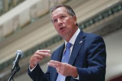In this Aug. 25, 2016, file photo, Ohio Gov. John Kasich speaks at the Regional Judicial Opioid Initiative opening summit in Cincinnati