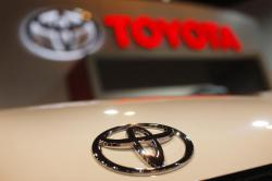In this April 17, 2010 file photo, a Toyota emblem is seen on a car during the Denver Auto Show in Denver