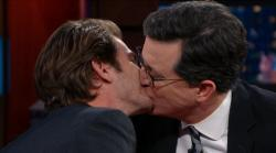 Andrew Garfield kisses Stephen Colbert.