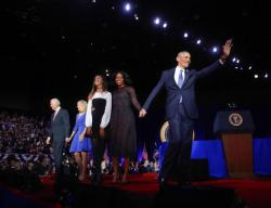 President Barack Obama waves on stage with first lady Michelle Obama, daughter Malia, Vice President Joe Biden and his wife Jill Biden after his farewell address at McCormick Place in Chicago.