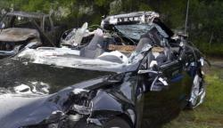 In this photo provided by the National Transportation Safety Board via the Florida Highway Patrol, a Tesla Model S that was being driven by Joshua Brown, who was killed when the Tesla sedan crashed while in self-driving mode on May 7, 2016