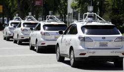 This May 13, 2014, file photo shows a row of Google self-driving Lexus cars at a Google event outside the Computer History Museum in Mountain View, Calif.