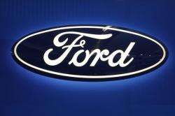This Feb. 11, 2016, file photo shows the Ford logo on display at the Pittsburgh International Auto Show in Pittsburgh
