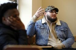 In this Friday, Jan. 20, 2017, photo Kenny Gutierrez, a junior business management major at Kean University in Union, N.J., talks about fake news during his journalism class
