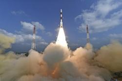 This photograph released by Indian Space Research Organization shows its polar satellite launch vehicle lifting off from a launch pad at the Satish Dhawan Space Centre in Sriharikota, India, Wednesday, Feb.15, 2017