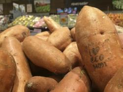 Laser branded sweet potatoes are displayed at the ICA Kvantum supermarket in Malmo, Sweden.