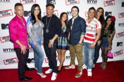 "Jersey Shore cast members, from left to right, Mike ""The Situation"" Sorrentino, Jenni ""JWoww"" Farley, Paul ""Pauly D"" Delvecchio, Deena Cortese, Vinny Guadagnino, Ronnie Ortiz-Magro, Sammi ""Sweetheart"" Giancola and Nicole ""Snooki"" Polizzi pose."