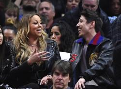 Singer Mariah Carey, left, talks with Bryan Tanak