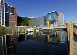 The Great Lakes Research Center is reflected in the waters of the docking area with RV Agassiz ready to go at Michigan Tech University in Houghton, Mich.