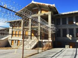 In this March 3, 2017 photo, razor wire is coiled along a fence at the closed Mount McGregor Correctional Facility in Wilton, N.Y.