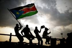 In this Sunday, July 10, 2011 file photo, Southern Sudanese wave the national flag and cheer at South Sudan's first national soccer match after the country declared its independence, in the capital Juba