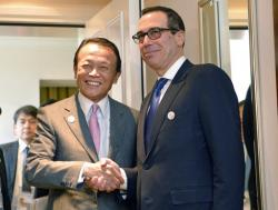 Japanese Finance Minister Taro Aso, left, and U.S. Treasury Secretary Steven Mnuchin meet for talks ahead of the G-20 Finance Ministers meeting in Baden-Baden, southern Germany, Friday, March 17, 2017