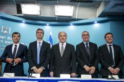 In this Tuesday, 14 March 2017 photo, from left: co-founder and CTO of Mobileye Prof. Amnon Shashua, Israeli Economy Minister Eli Cohen, Israeli Prime Minister Benjamin Netanyahu, Intel CEO Brian Krzanich and the co-founder and CTO of Mobileye, Ziv Aviram, attend a press conference at the Prime Minister's Office in Jerusalem