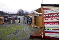 Tiny living pods for the Kenton Neighborhood Tiny Home Pilot houses are viewed in Portland, Ore.