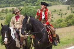 "osh Gad, left, and Luke Evans appear in a scene from, ""Beauty and the Beast."""