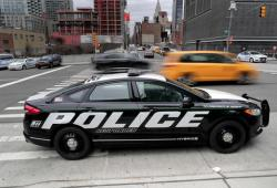 In this Friday, April 7, 2017, photo, a prototype of the Ford Fusion police hybrid car sits along 11th Avenue in New York