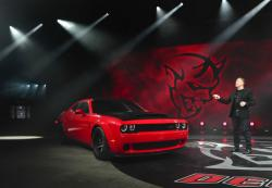 Dodge head of passenger car brands Tim Kuniskis talks about features for the 2018 Dodge Challenger SRT Demon during a media preview for the New York International Auto Show, Tuesday, April 11, 2017, in New York