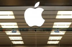 This Thursday, Sept. 19, 2013, file photo shows the Apple logo above a store location entrance, in Dallas.