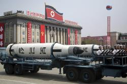 In this Saturday, April 15, 2017, file photo, a submarine missile is paraded across Kim Il Sung Square during a military parade in Pyongyang, North Korea.