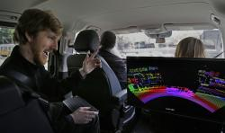 In this photograph taken on Monday, April 10, 2017, Luminar CEO Austin Russell gestures while looking at a 3D lidar map on a demonstration drive in San Francisco