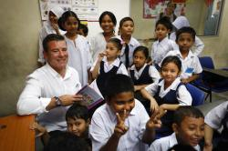 In this Jan. 26, 2017, file photo, New Zealand Immigration Minister Michael Woodhouse, left, smiles as he interacts with refugee students during his visit to the UNHCR Tzu Chi Education Centre in Selayang, outskirts of Kuala Lumpur, Malaysia