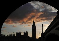 A silhouette of the Houses of Parliament and Elizabeth Tower containing Big Ben, centre, at dusk, in Westminster, London, Tuesday April 18, 2017
