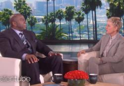 Magic Johnson, left, speaks with Ellen DeGeneres