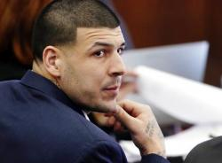 In this Wednesday, March 15, 2017, file photo, Defendant Aaron Hernandez listens during his double murder trial in Suffolk Superior Court, in Boston.