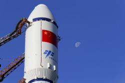 In this Monday, April 17, 2017 photo released by China's Xinhua News Agency, a Long March 7 rocket carrying the Tianzhou 1 is transferred to the launching site in Wenchang, south China's Hainan Province